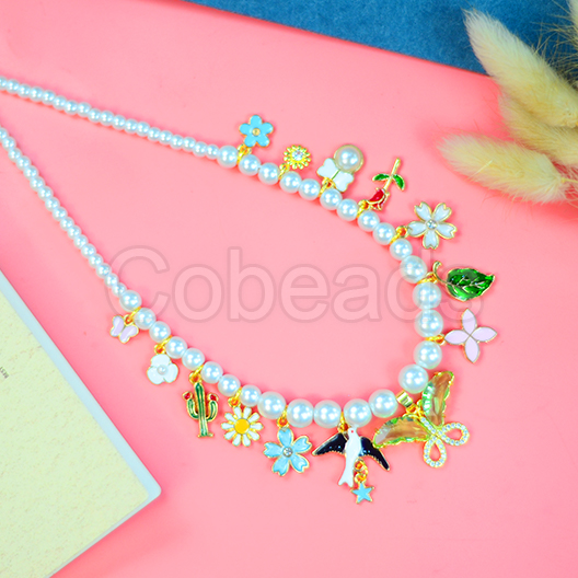 Elegant Pearl Necklace With Cute Enamel Pendants